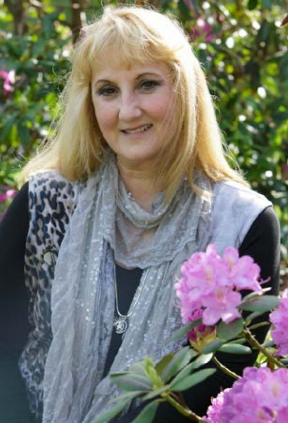 Joan Witherell wearing gray scarf over black blouse